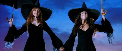The Owens sisters in full witchy garb.
